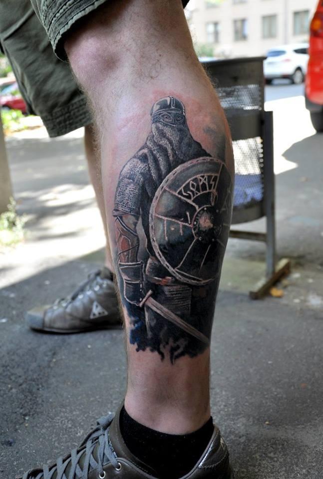 Славянские тату на ноге
